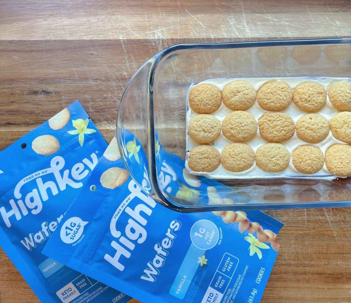 keto cookies on top of eclair cake in glass baking dish