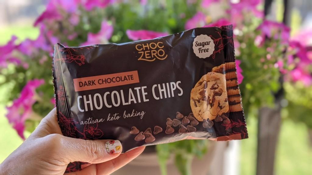 holding a bag of ChocZero sugar-free chocolate outside