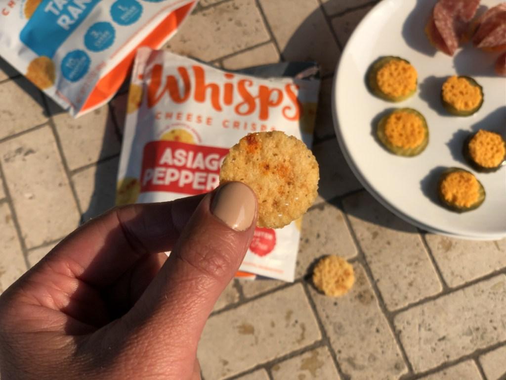 Whisps cheese crisps holding asiago pepper jack