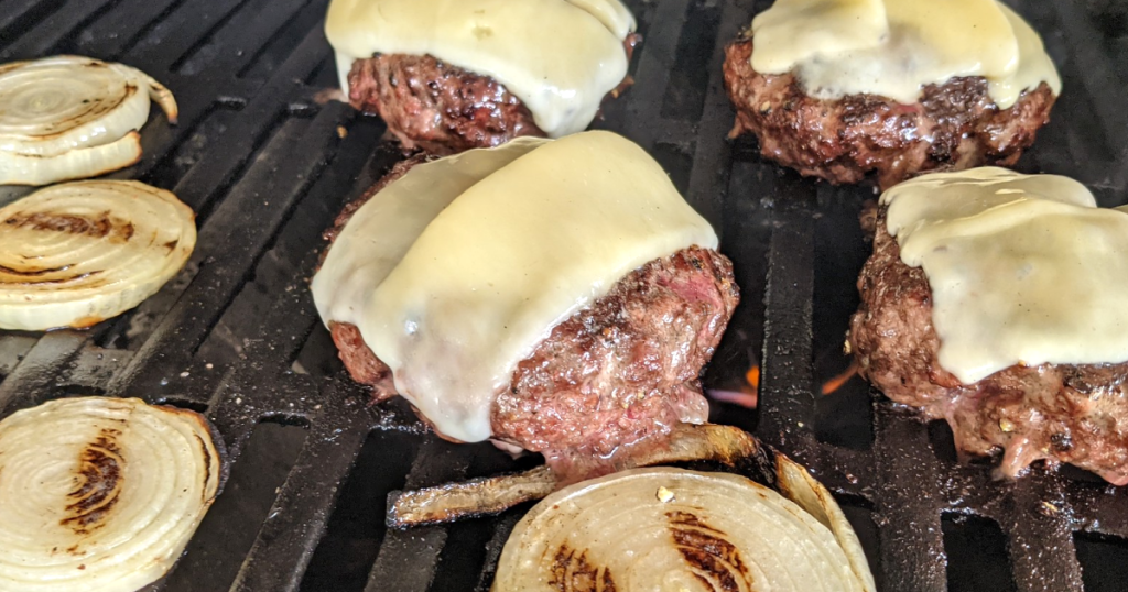 Gordon Ramsay cheeseburgers and onions on grill
