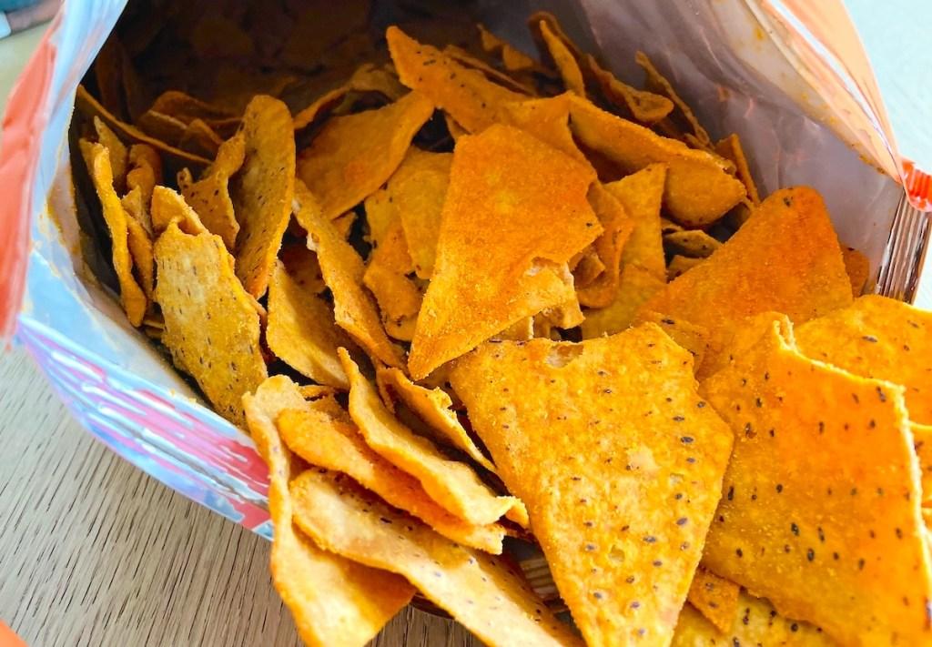 close up of orange chips spilling out of bag