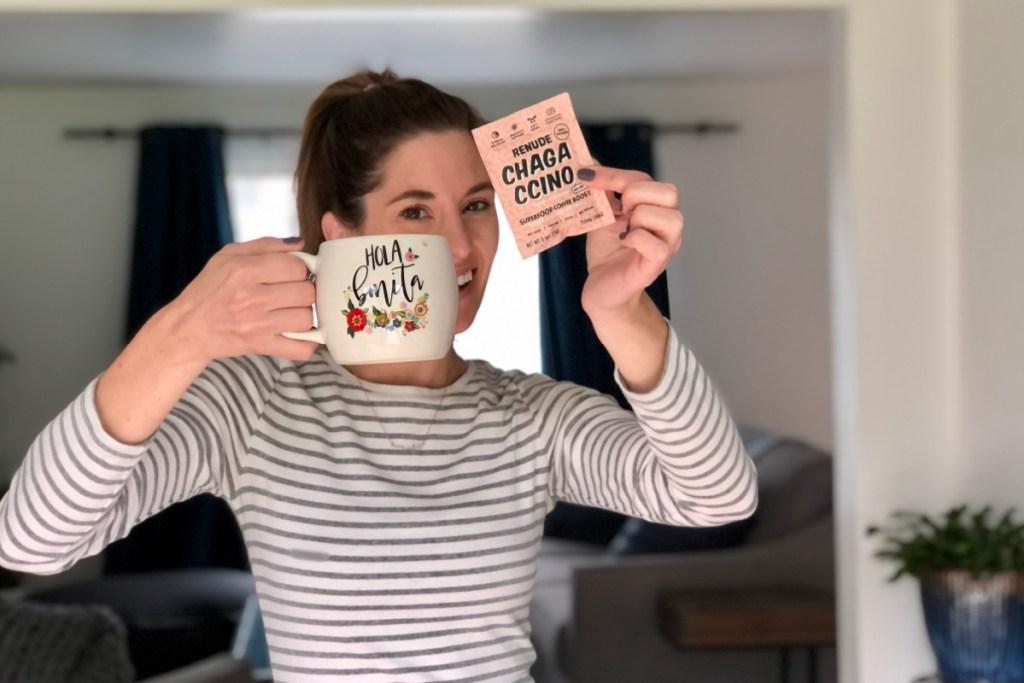 woman holding mug and packet of chagaccino mix