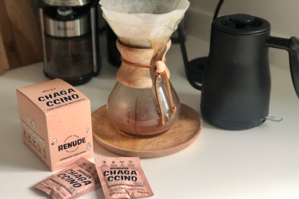 box of chagaccino packets and pour over coffee maker on countertop