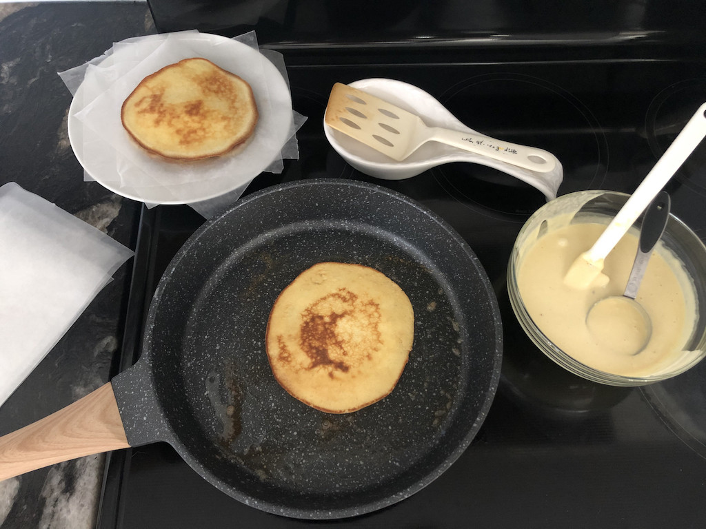 keto crepes cooking in skillet