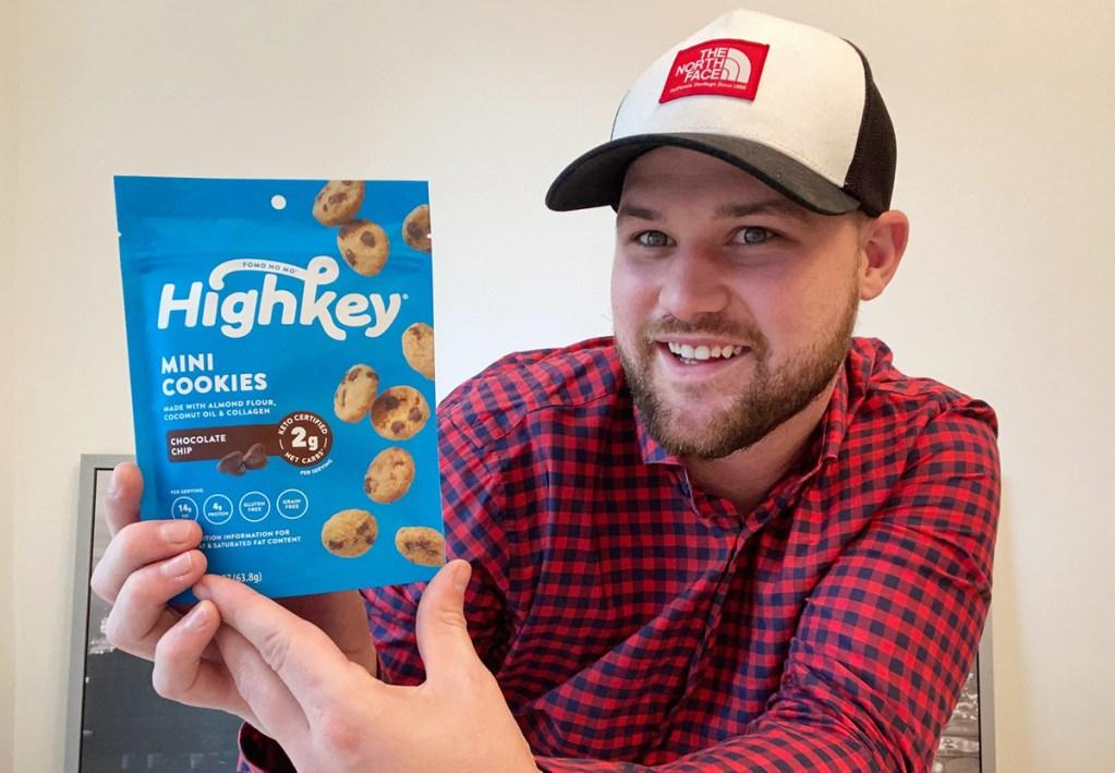 man holding high key cookies