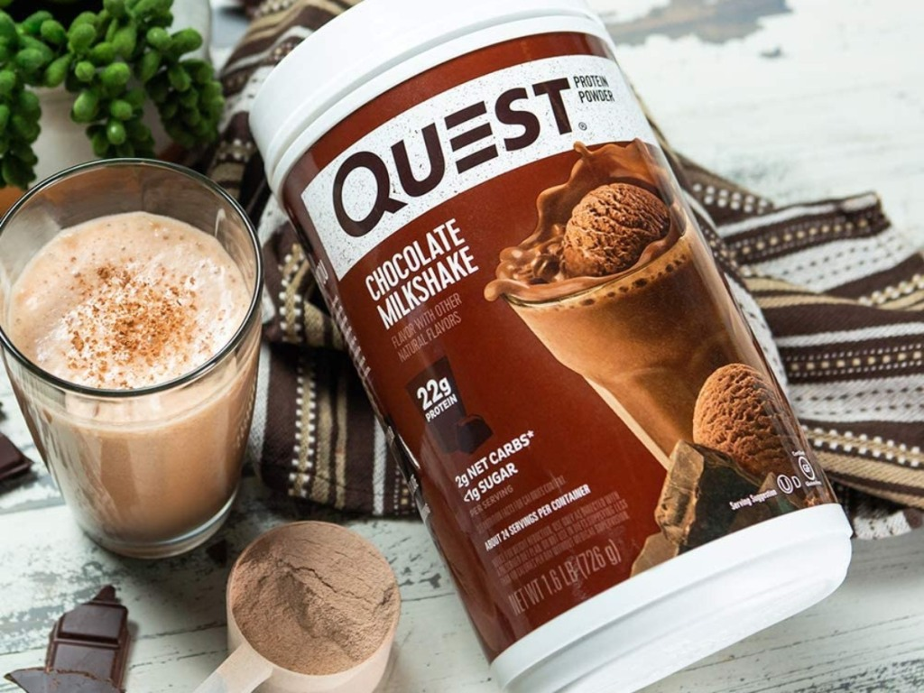 chocolate protein shake next to canister