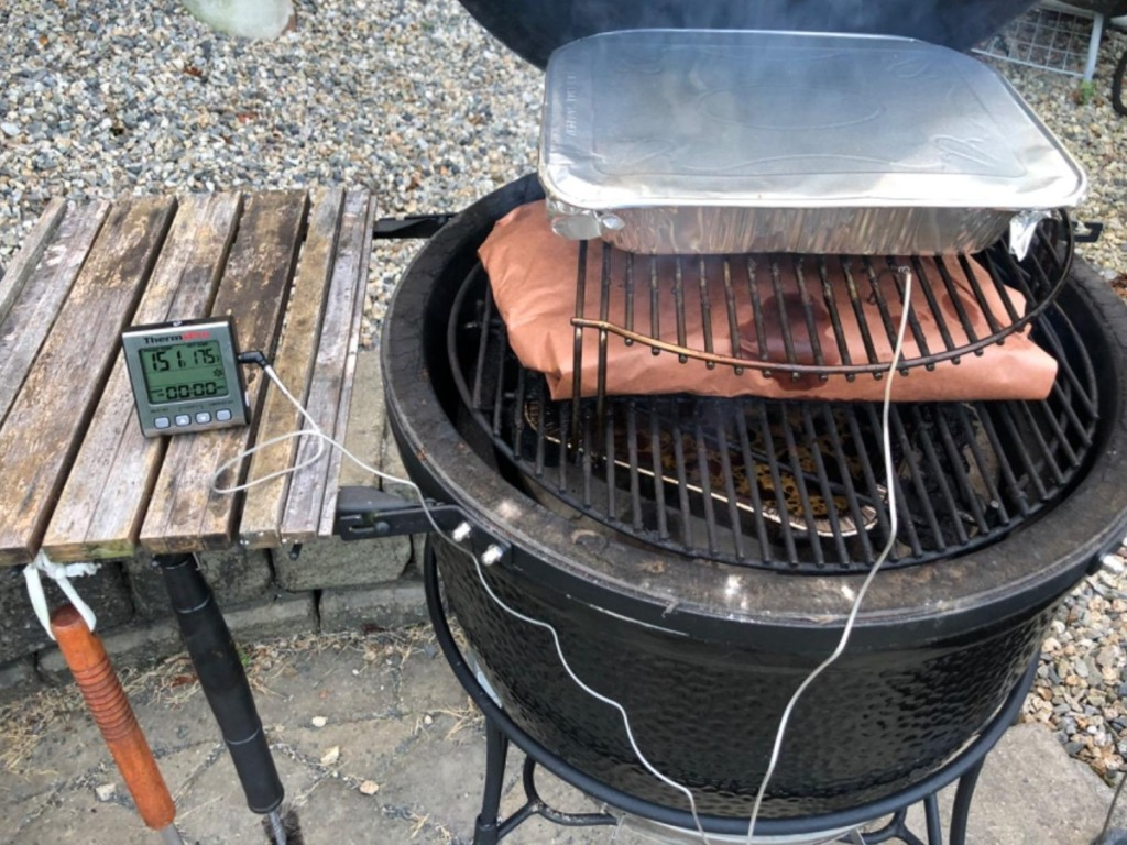 meat thermometer next to smoker