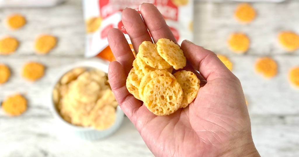 hand holding whisps cheese crisps