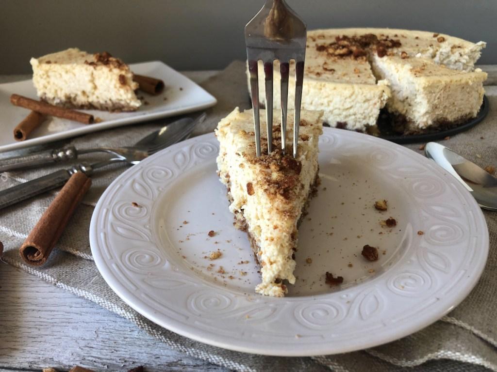 fork in a slice of keto churro cheesecake