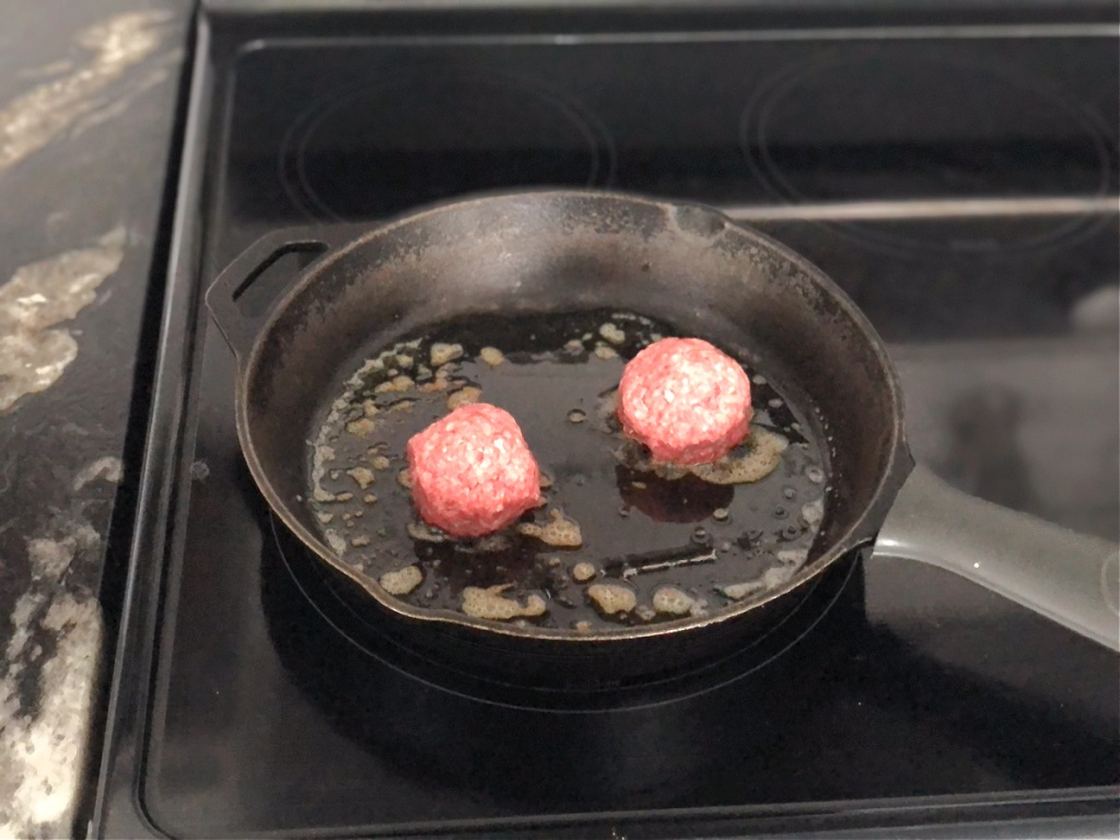 ground beef balls in a skillet