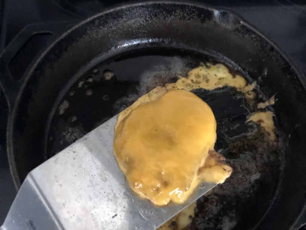 melted cheese on a burger