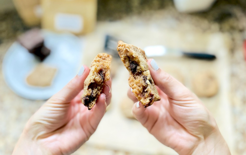 hand pulling apart keto chocolate chip cookie