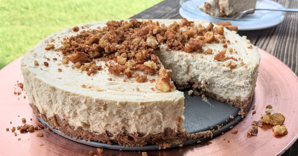 keto churro cheesecake in pan with slice taken out