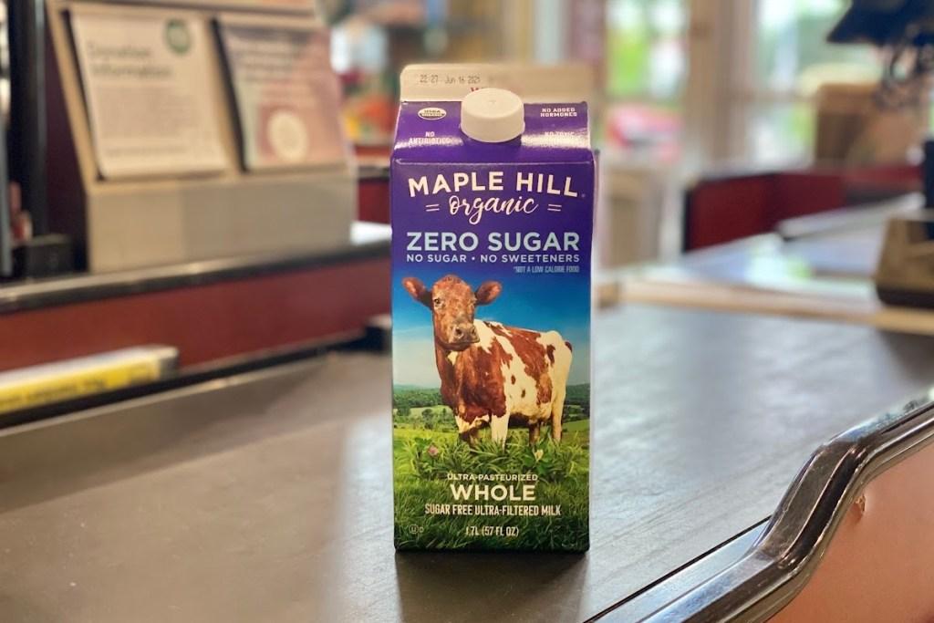 Maple Hill milk carton on store conveyor