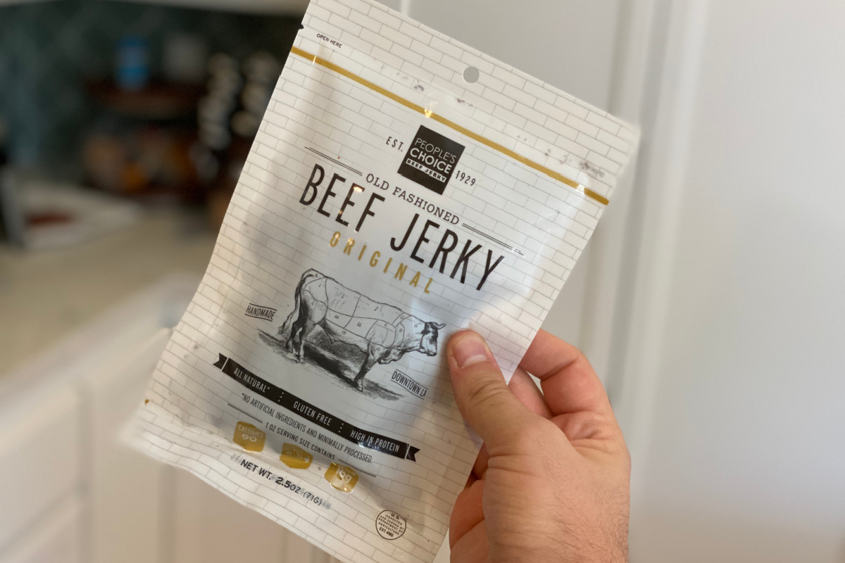 hand holding a people's choice jerky package
