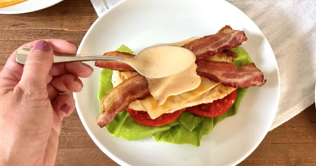 adding sauce to keto chicken-fil-a grilled chicken sandwich