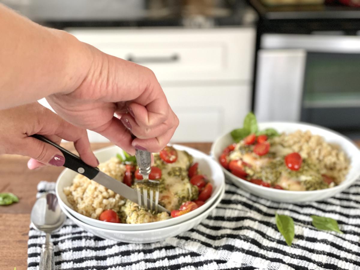 cutting chicken in Grilled Chicken Margherita Olive Garden