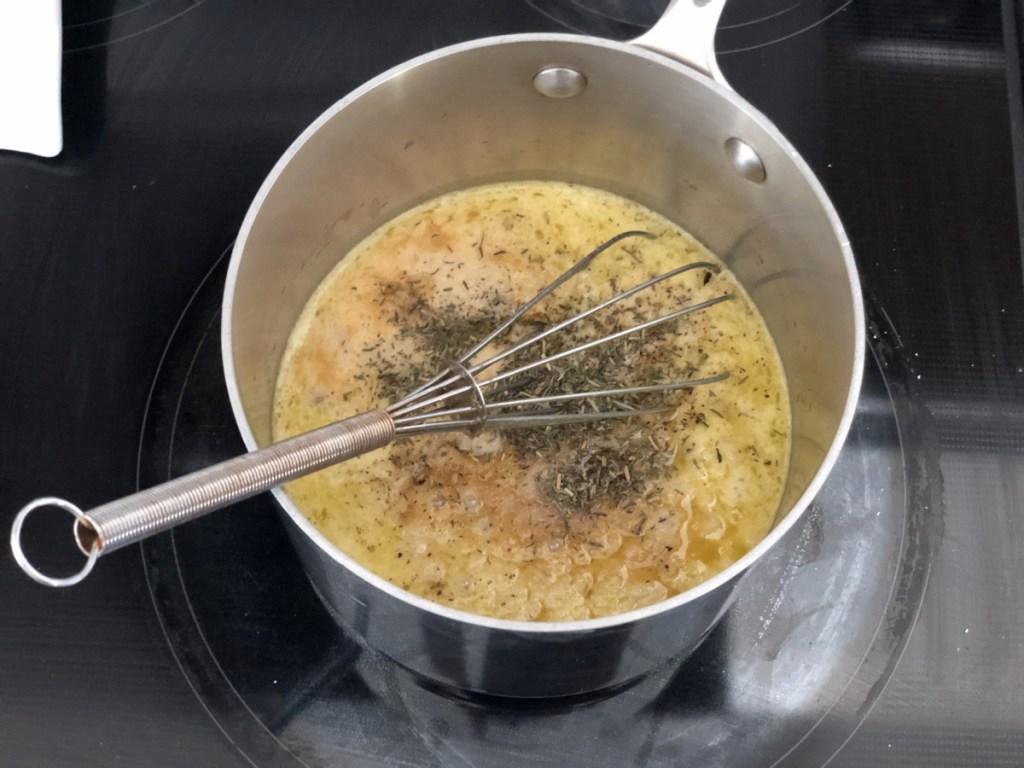 cooking keto gravy in a saucepan