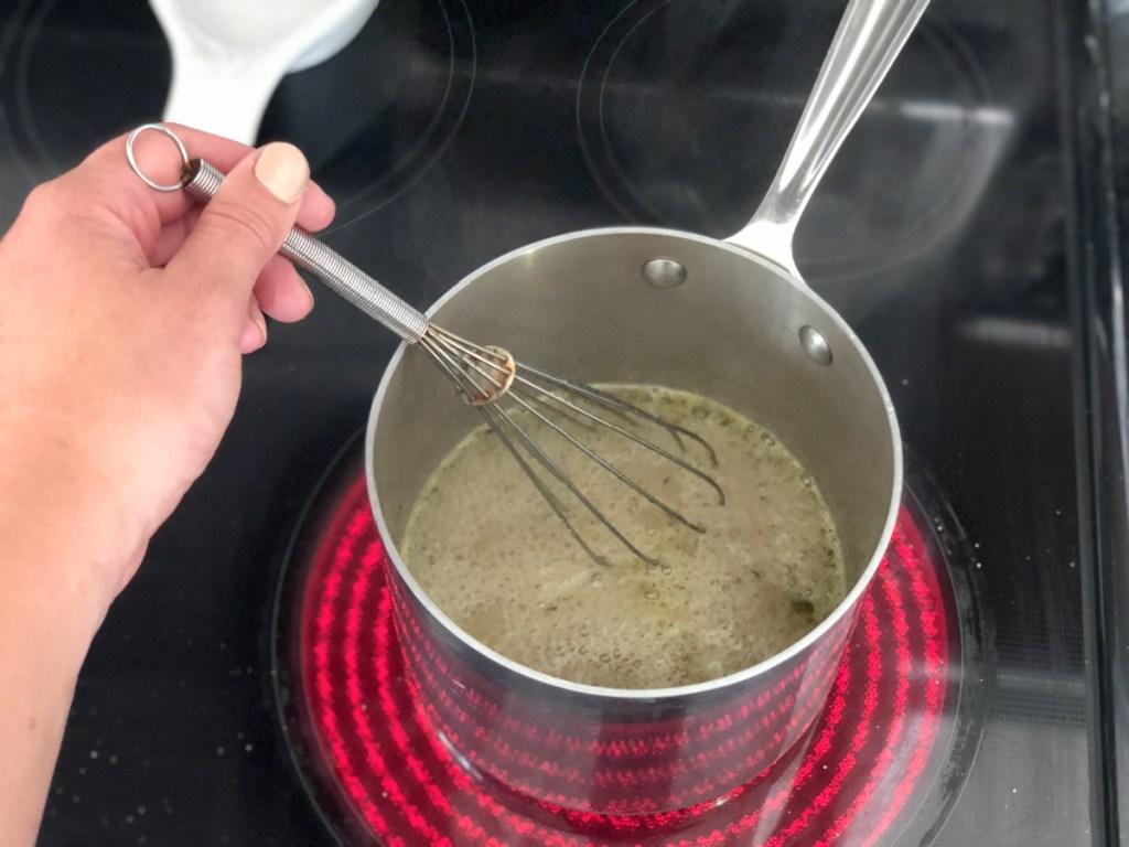 mixing keto gravy in a saucepan