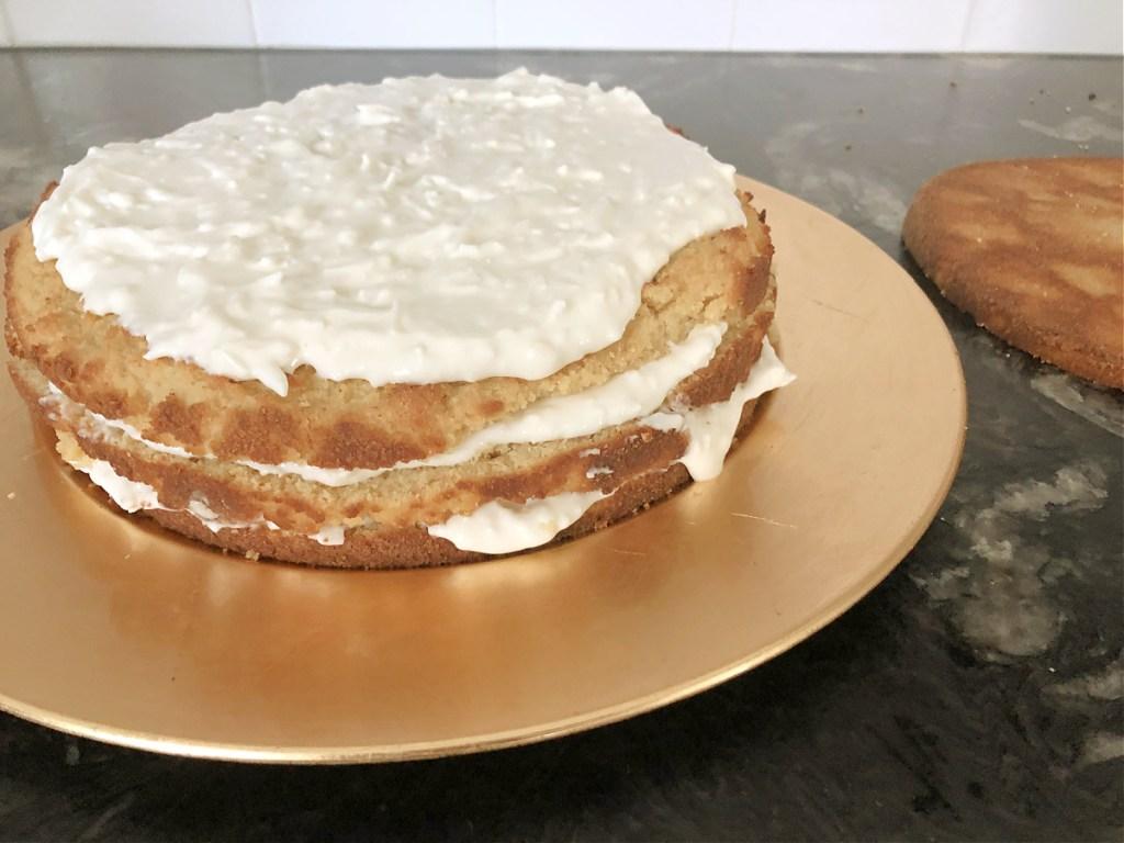 assembling keto coconut cake