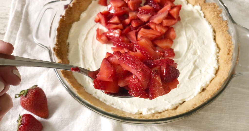 spoonful of strawberries in front of sugar free keto strawberry pie