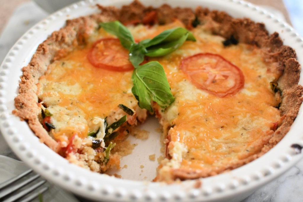 baked tomato pie with a slice cut out