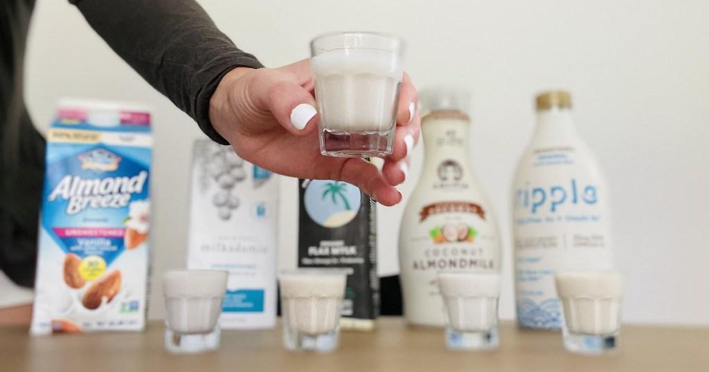 hand holding shot glass full of dairy free keto milk