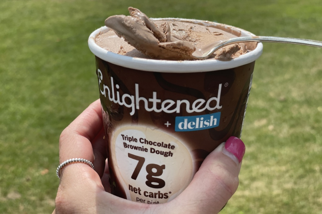 holding a pint of Enlightened triple chocolate brownie dough ice cream