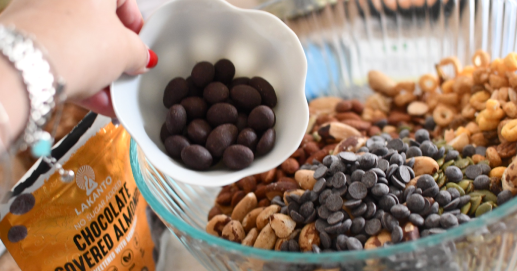 putting keto trail mix in bowl