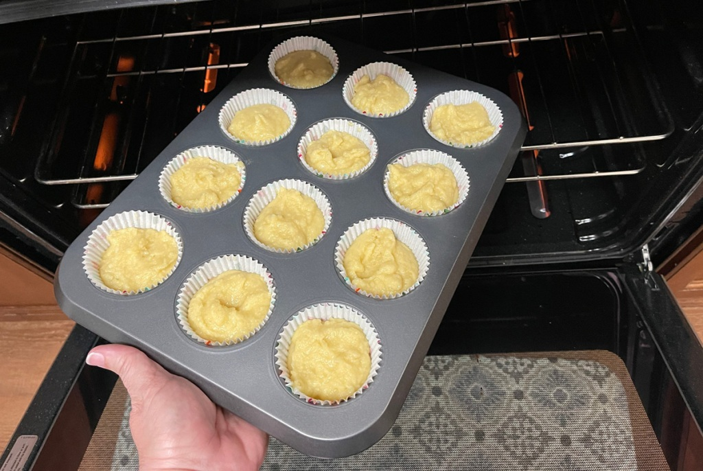 putting cupcakes in the oven