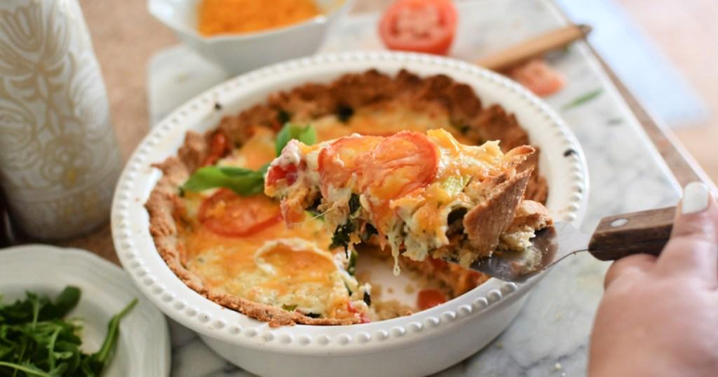 slice of keto tomato pie on a pie cutter