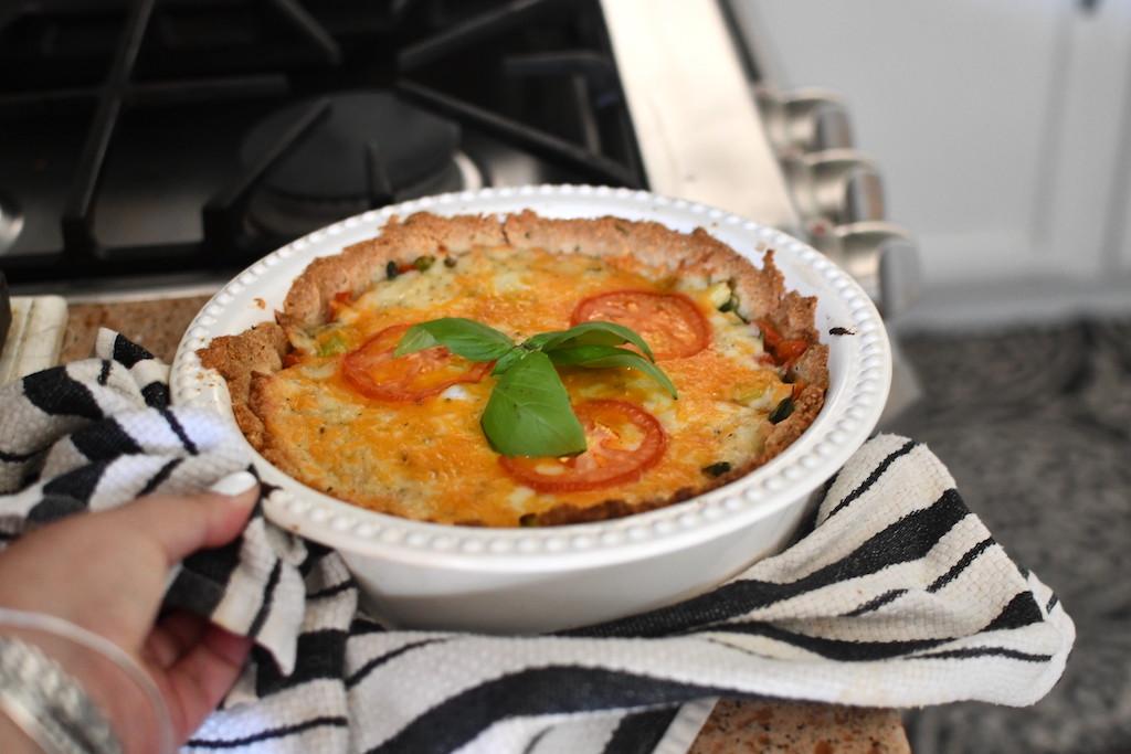 taking keto tomato pie out of oven