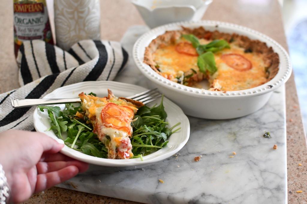 serving keto tomato pie with salad