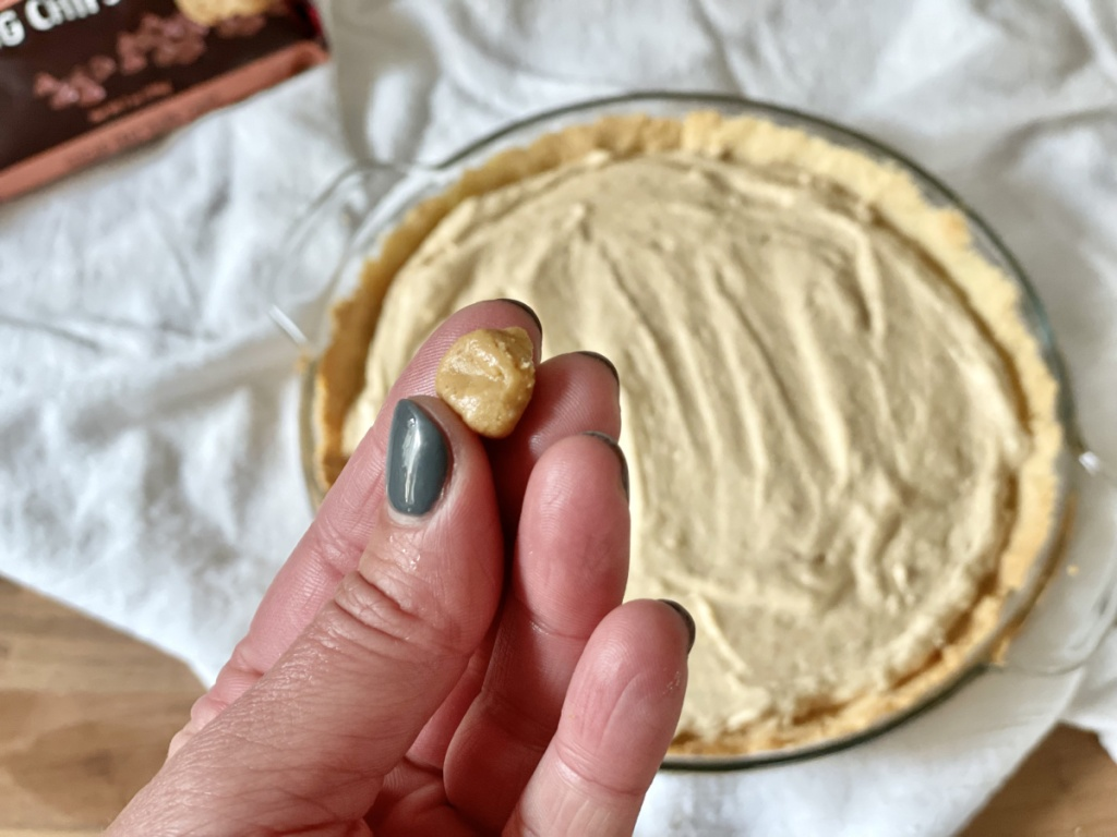 adding toppings to keto peanut butter pie