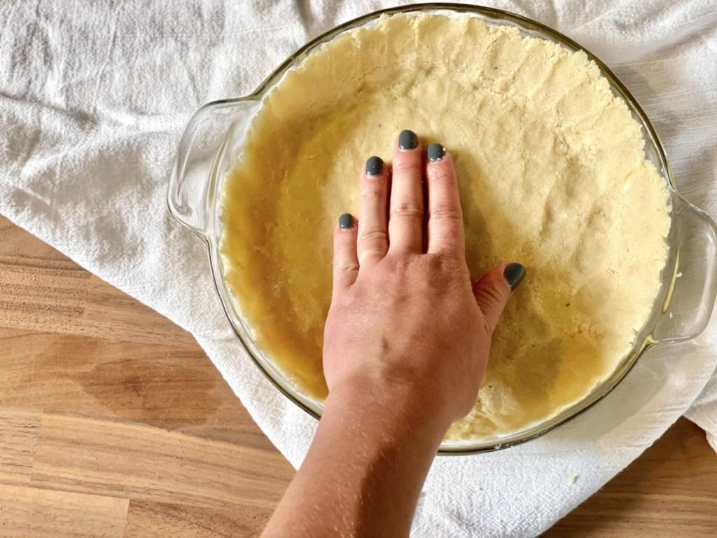 pressing almond flour crust for keto peanut butter pie