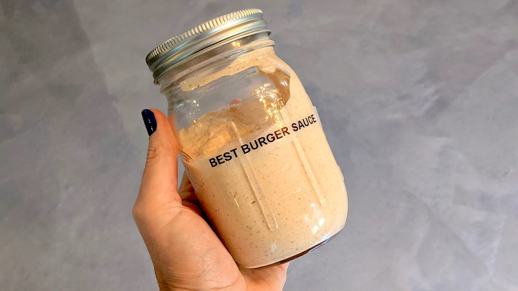 holding jar of keto burger sauce