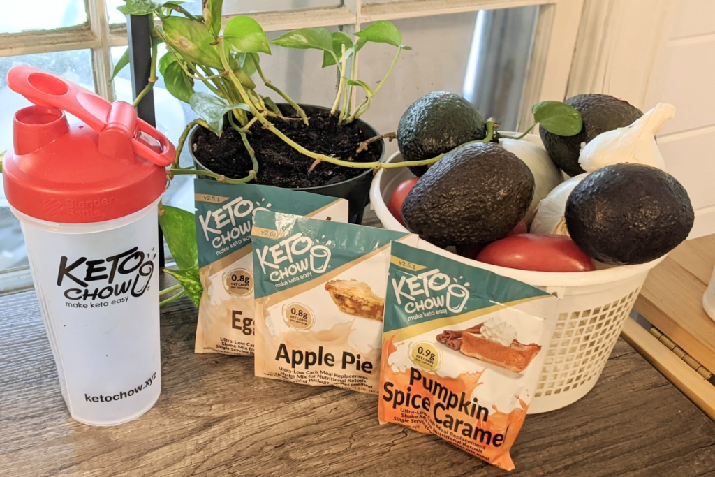 Keto Chow packets and tumbler on counter