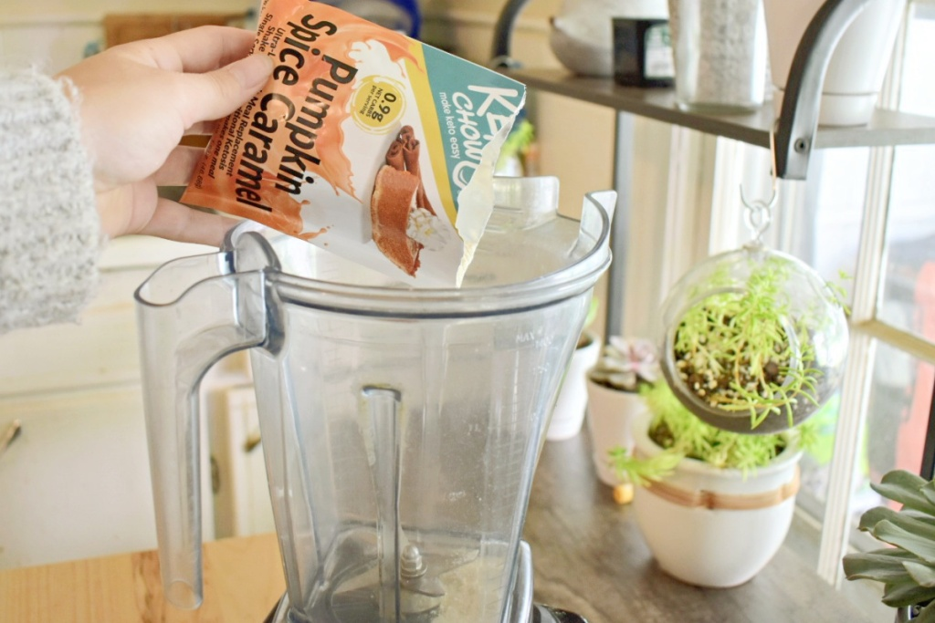 pouring packet of Pumpkin Spice Caramel Keto Chow into blender